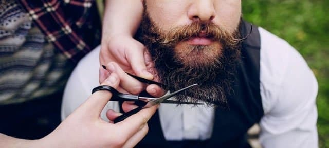 cutting beard with shears - tools of men