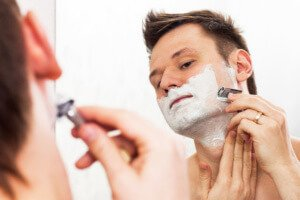 shaving in a mirror - is pre shave oil necessary