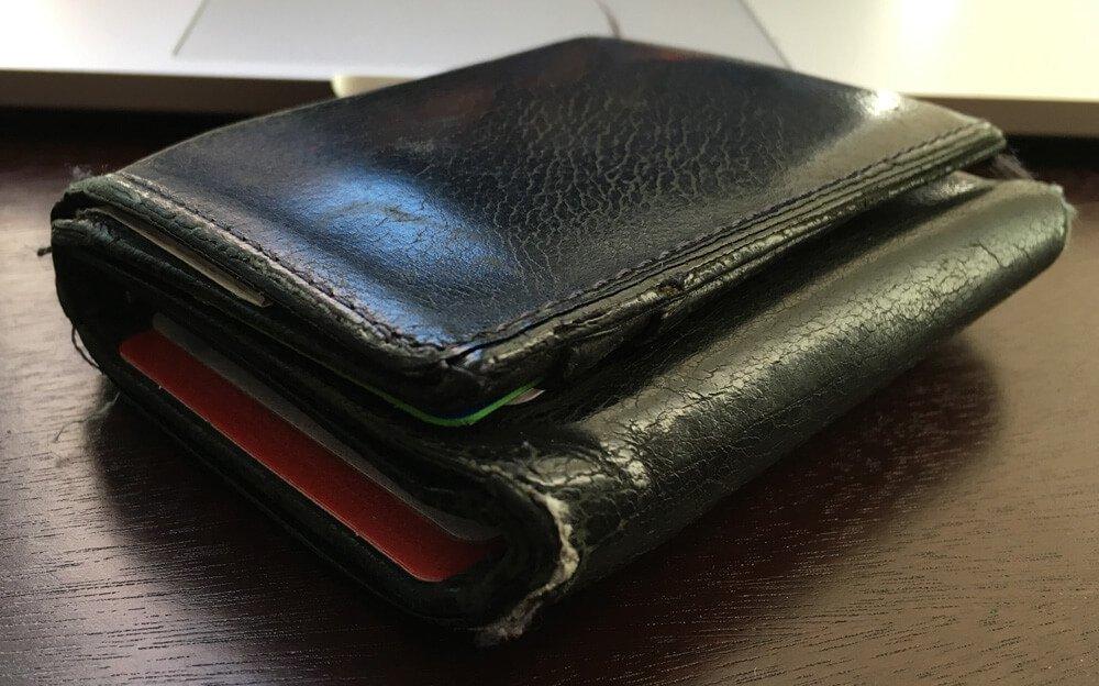 worn tri fold wallet