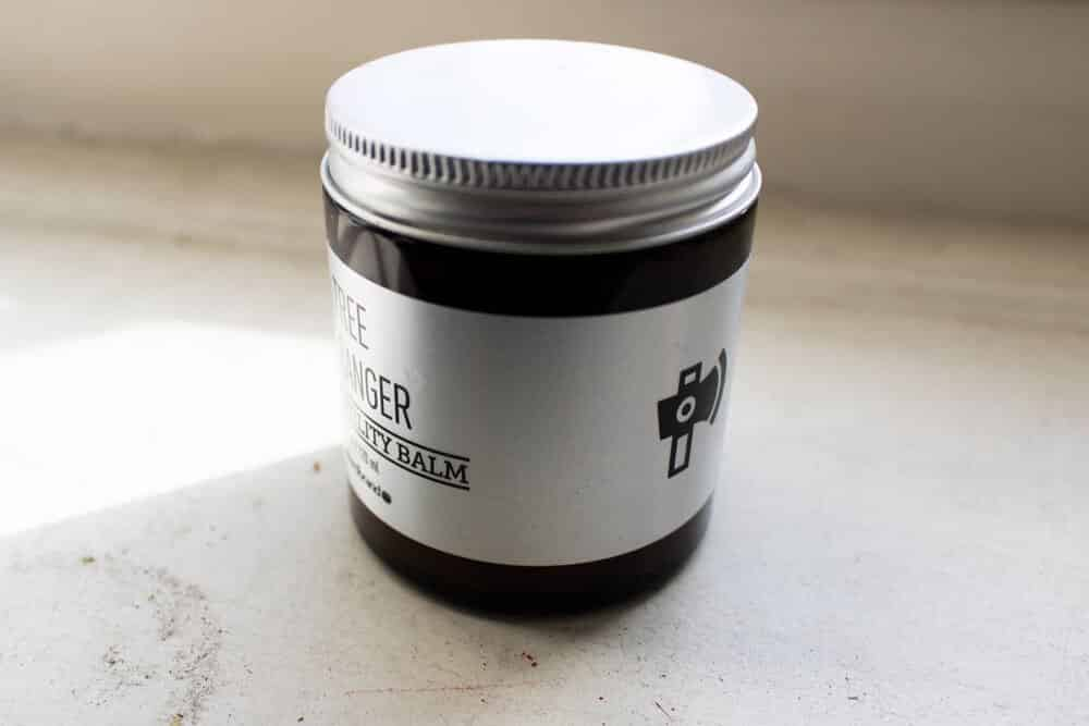 old pomade or balm jar to dispose of razors