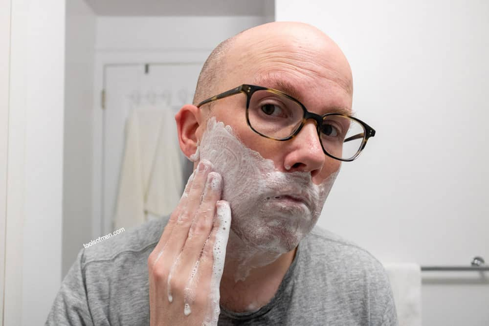 adding water to a hand lather onto your face