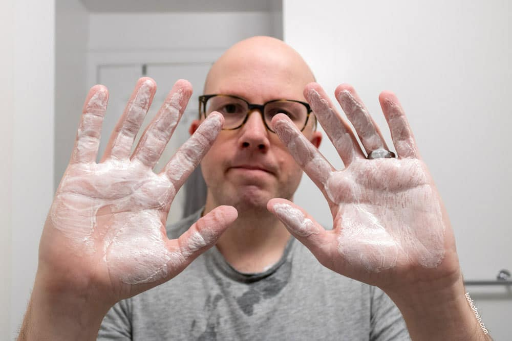 mixing shaving cream on dry hands for even consistency