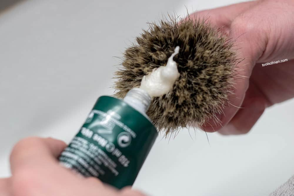 loading a shaving brush with Proraso shaving cream