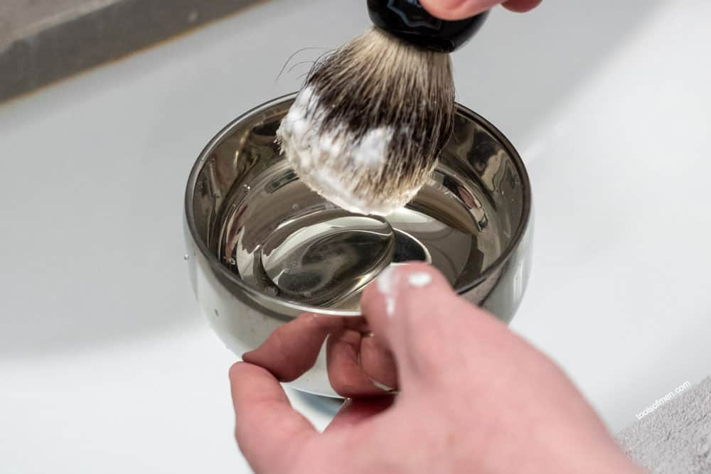 mixing loaded shave brush in a bowl