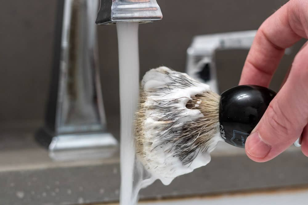 soaking tips of shaving brush to add water